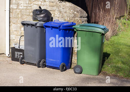 Rubbish bins standing on a driveway. - Stock Photo