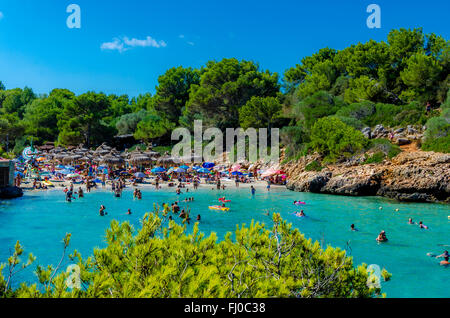 Spain, Mallorca, Cala Sa Nau, beach and tourists - Stock Photo