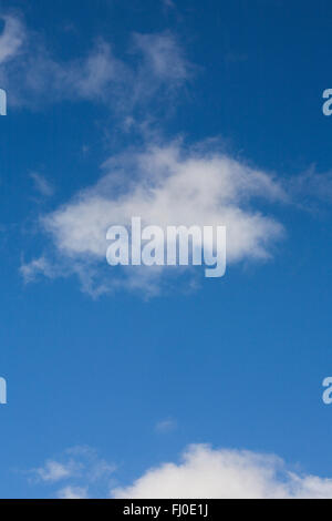 White clouds in a blue sky on a Winter's day. - Stock Photo