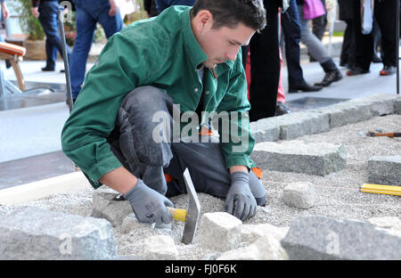 Munich, Germany. 26th Feb, 2016. Landscape gardener Andreas Kormpos works at a booth at the Internationale Handwerksmesse - Stock Photo