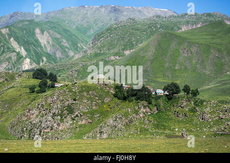 Small village seen from Georgian Military Road, historic route through Caucasus Mountains from Georgia to Russia - Stock Photo