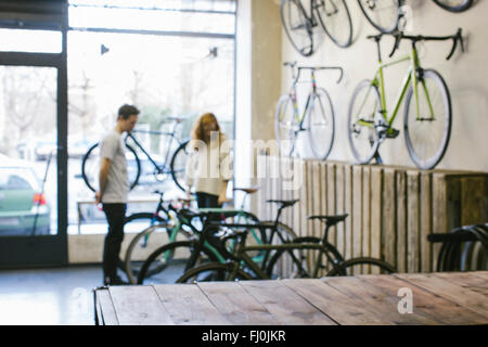 Salesman and client in a custom-made bicycle store - Stock Photo