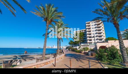 Mid morning sun on Ibiza waterfront.  People out on a sunny day.  Balearic beachfront hotel, St Antoni de Portmany, - Stock Photo
