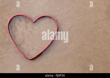 Red Heart in the sand - Stock Photo