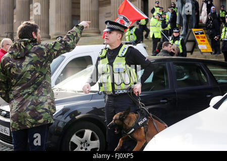 Liverpool, UK. 27th Feb, 2016. A Police Dog handler speaking to an anti racist protester in Liverpool, UK 27th February - Stock Photo