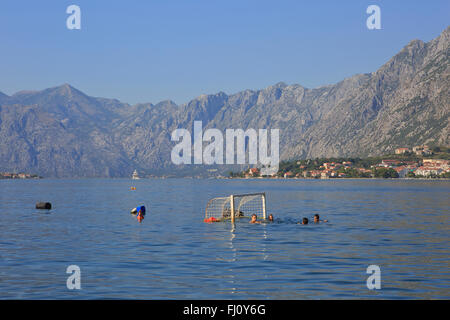 Kids playing water polo in the Bay of Kotor near Perast, Montenegro - Stock Photo