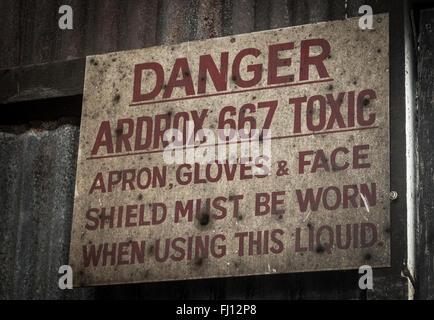 'Danger' warning sign in abandoned industrial buildings on Cockatoo Island near Sydney, Australia. - Stock Photo