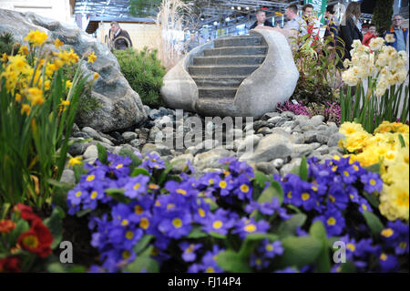 Munich, Germany. 26th Feb, 2016. A garden well and flowers cann be seen at the International Handcraft Fair IHM - Stock Photo