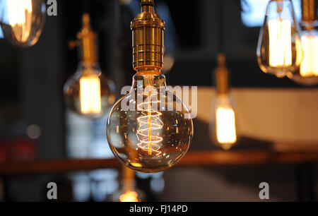 Munich, Germany. 26th Feb, 2016. Lightbulbs hanging at a stand at the International Handcraft Fair IHM in Munich, - Stock Photo