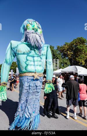 Miami Beach Florida Art Deco District Ocean Drive Art Deco Weekend annual event fair festival Neptune character - Stock Photo