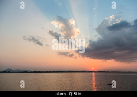 Stunning sunset over the Mekong river in Pakse in Champasak province in south Laos. - Stock Photo