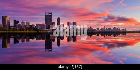 still reflection of Perth Western Australian capital at sunrise in calm waters of Swan River. Horizontal panorama - Stock Photo