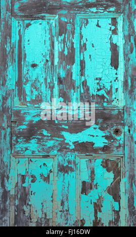 Peeling paint on an old wooden door - Stock Photo