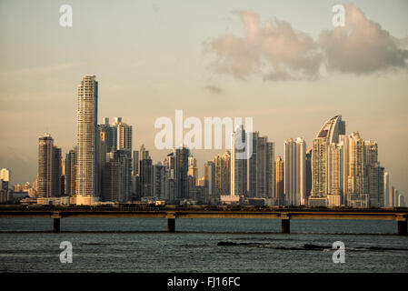 PANAMA CITY, Panama--The fading golden glow of the setting sun catches the modern skyscrapers of the skyline of - Stock Photo