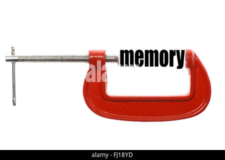 The word 'memory' is compressed with a vice. - Stock Photo