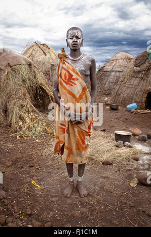 Stunning portrait of Mursi woman in front of her house , Mago National Park , Ethiopia - Stock Photo