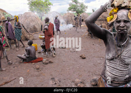 Stunning portrait of Mursi woman in typical traditional Mursi village, Mago National Park , Ethiopia - Stock Photo