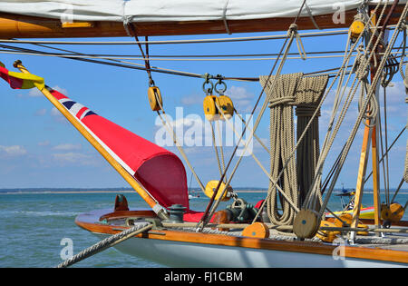 Stern of beautiful wooden traditional classic yacht moored at Cowes during Classic Week, Cowes, Isle of Wight, UK, - Stock Photo