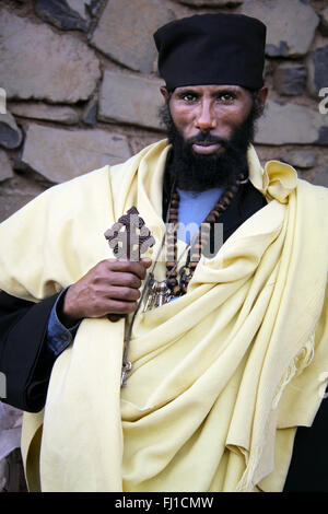 Portrait of Orthodox priest with cross in Gonder , Ethiopia - Stock Photo