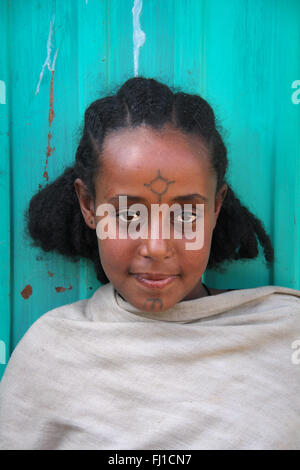 Portrait of Ethiopian girl with tattoo on her face in Gonder , Ethiopia - Stock Photo