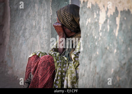 Woman beggar in the streets of Harar , Ethiopia , with Meadow - Stock Photo