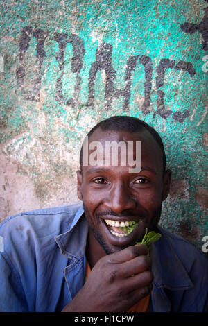 Man chewing  in Khat Harar, Ethiopia - people, architecture and streetlife - Stock Photo