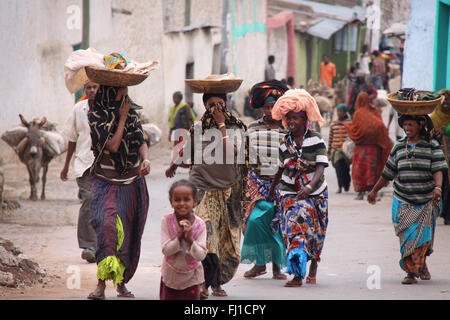 Group of women walking in a street of Harar , Ethiopia - Stock Photo