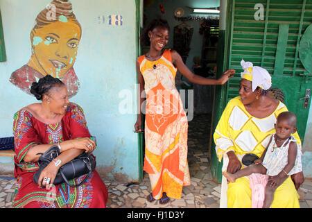 Welcome home !  women talking at entrance of a house in Ouagadougou, capital of Burkina Faso , Africa - Stock Photo