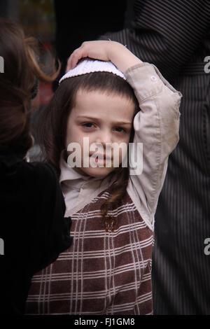 Jewish kid child wearing traditional kippa on Friday during Shabbat in Jerusalem , Israel - Stock Photo