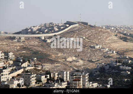 Separation wall between Israel and Palestine, seen from Jerusalem ,and Israeli jewish settlements - Stock Photo