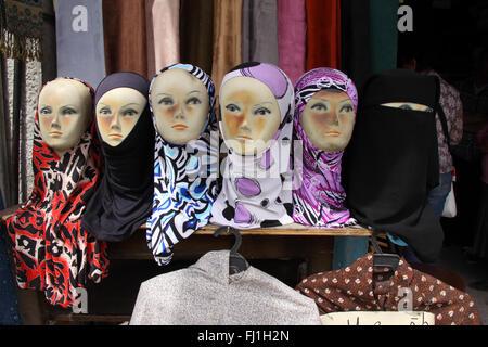 Islamic veils seller in the streets of Amman, Jordan - Stock Photo