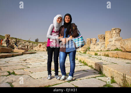 Two Jordanian teen girls on the site of Jerash, Jordan - Stock Photo