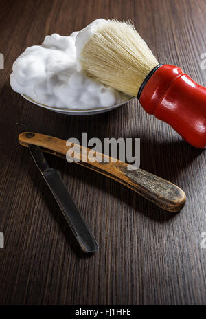 Old razor with shaving brush and foam. - Stock Photo