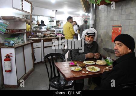 Two men eating in restaurant in Ramallah, Palestine - Stock Photo