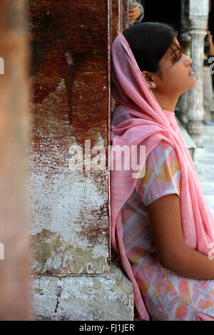 Sikh woman alone in temple, Amritsar, India - Stock Photo
