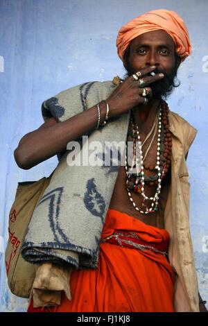 Sadhu / Hindu holy man smoking in Pushkar , India - Stock Photo