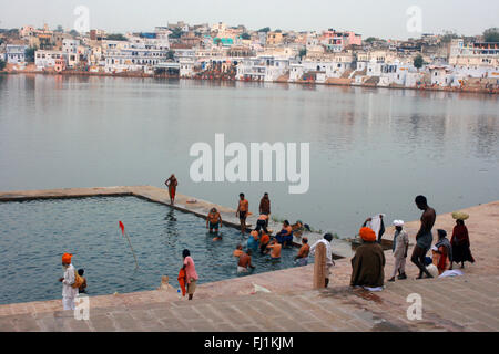 Hindy pilgrims gather around Pushkar holy lake , Rajasthan , India - Stock Photo