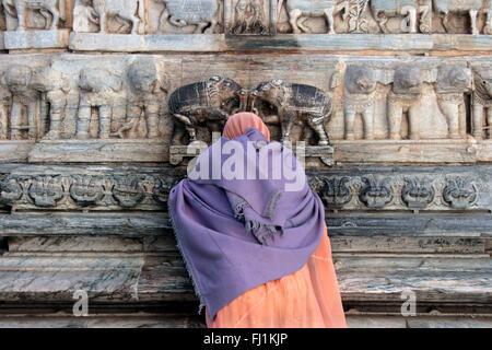 Woman praying at Jagdish Temple, Udaipur, Rajasthan, India - Stock Photo