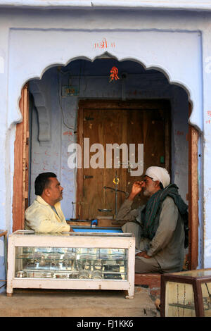 Two men are talking in Jaisalmer, India - Stock Photo