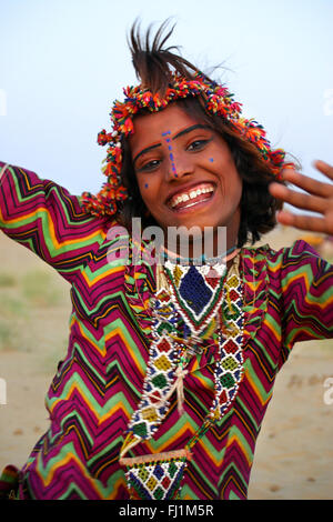 Happy girl dancing in Jaisalmer , Rajasthan, India - Stock Photo