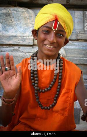 Young Sadhu Hindu holy man  with Rudraksha mala necklace in Udaipur , India - Stock Photo