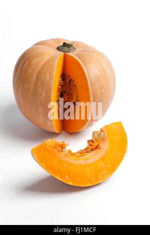 Fresh raw pumpkin with a slice on white background - Stock Photo