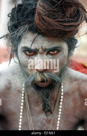 Sadhu -  Indian Hindu holy man saint  - covered with ashes - Varanasi  India - Stock Photo