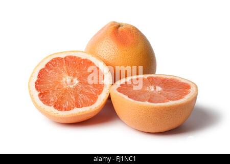 Whole and half fresh grapefruit on white background - Stock Photo