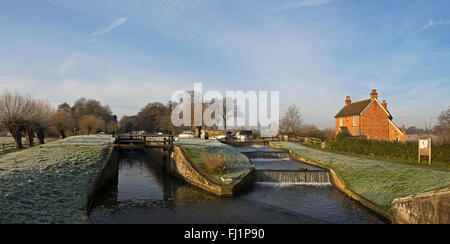 Papercourt lock and weir on the River Wey navigation in Surrey on a still clear frosty winters morning - Stock Photo