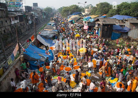 Crowd and people at the Kolkata Mullick ghat flower market , India - Stock Photo