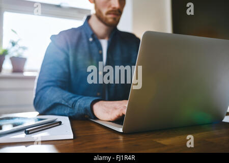 Close up view of man working on laptop business concept working concept - Stock Photo