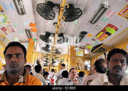 People passengers inside suburban train in Mumbai Bombay, India