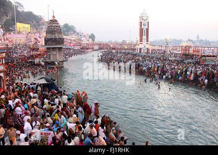 Crowd of Hindu people pilgrims at Har ki Pauri on the banks of the holy ganges during Kumbh mela festival  in Haridwar, - Stock Photo