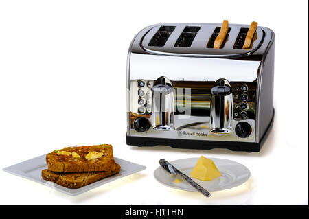 Four slice, chrome toaster with toast and butter. - Stock Photo